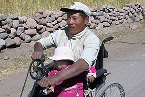 Disabled man in peru with wheel chair